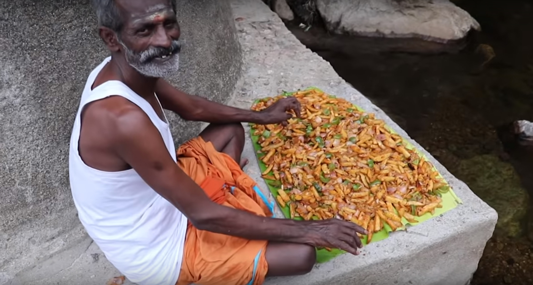 Indian man cooks for a village