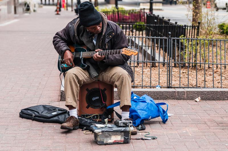 They give free music lessons to homeless people so they can make a living playing on the street.