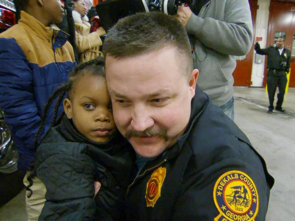 Firefighter reunited with resqued girl